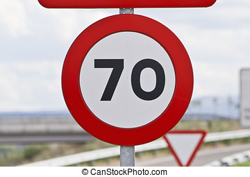 road sign that warns of speed limitation