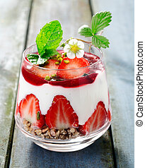 Delicious decorative strawberry dessert with halved...