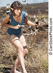 Elf on the prowl - Elfe when hunting with bow and arrow in...