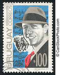 Gardel and Score - URUGUAY - CIRCA 1974: stamp printed by...