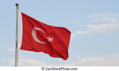 Turkish flag waving in front of blue sky