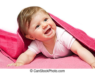 An adorable, laughing baby looking at camera