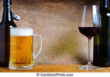 Beer and wine with text copy space on a wooden background