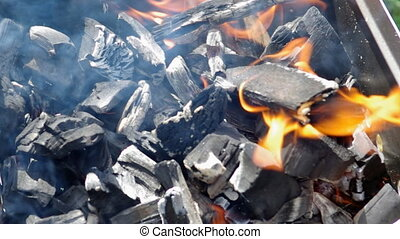 grill with charcoal and flames