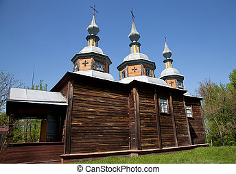 Wooden church with three domes