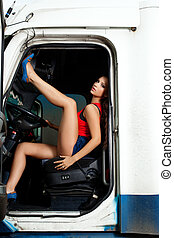 sexy young woman posing in truck cabin
