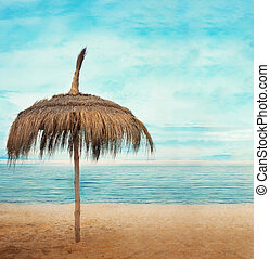Holiday concept - Straw parasol with cloudscape and calm sea...