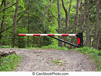 Barrier, blocking the road into the woods - The barrier,...