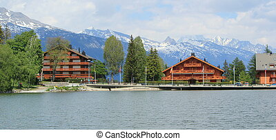 Chalets and Long lake in Crans Montana by summer,...