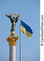 The Independence monument and ukrainian flag in Kiev....