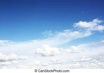 Fluffy clouds - white clouds on blue sky in season