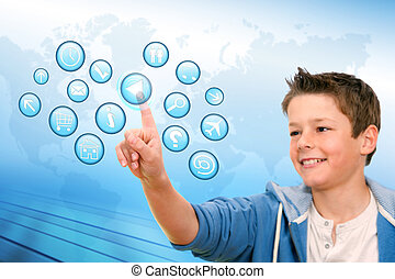 Boy pointing at web icons with futuristic interface. -...
