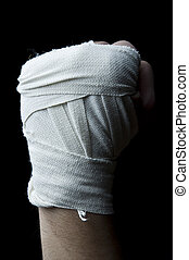 boxer fist with wrist wraps isolated on a black background