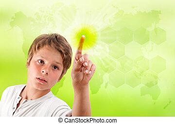 Boy touching futuristic green interface. - Boy touching...