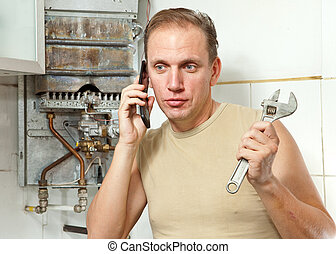 The man calls by phone to cause the repairman of gas water...
