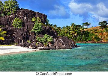 Black rocks. Bora-Bora. Polynesia