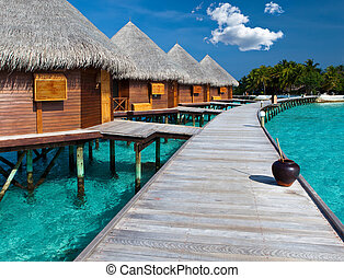 Island in ocean, Maldives Villa on piles on water