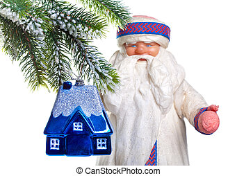 Father Frost (Santa Claus) and the toy house on a fur-tree - dream of own house