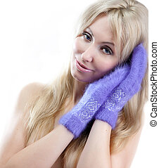 young woman in fluffy mittens