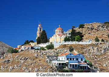 Greece. Dodecanesse. Island Symi (Simi). Colorful houses on...