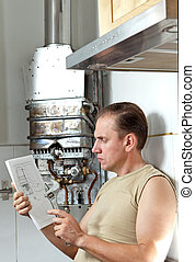 The man with a wrench thinks of repair of a gas water heater...