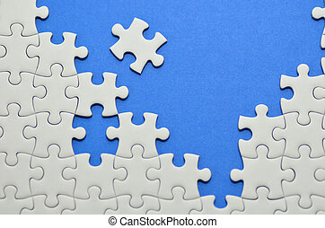 Jigsaw puzzle. - Plain white jigsaw puzzle, on Blue...