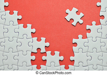 Jigsaw puzzle. - Plain white jigsaw puzzle, on Red...