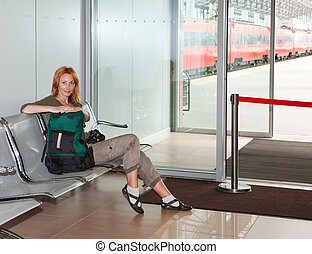 Waiting room and train behind transparent doors