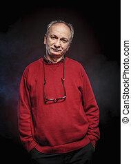 elderly man - Portrait of an elderly man wearing red jacket...