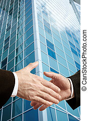 Business deal - concept with hands of businessmen and...