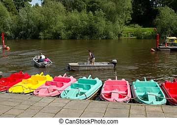 Boat trip. - A family prepares to cruise a river in an...