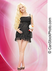 portrait of the expectant mother in a black dress with polka dot