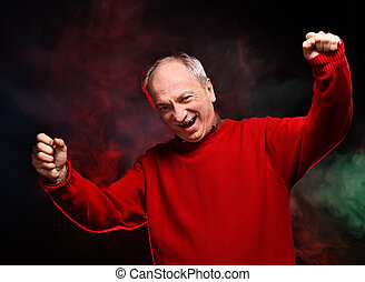 happy old man - Successful old happy man in a red sweater...