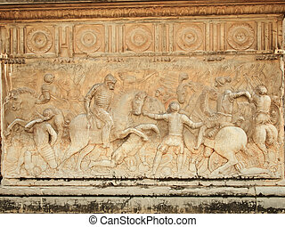 Alhambra, wall of Carlos V Palace. Relief carving of a battle scene.