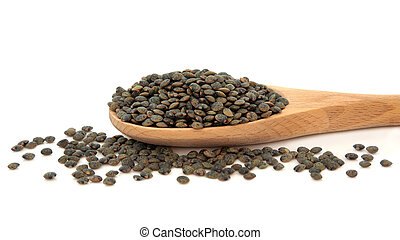Puy Lentils - Puy lentils in a wooden cooking spoon and...