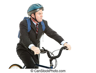 Biking to Work - Businessman riding his bicycle to work,...