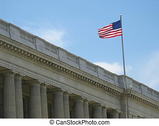 american flag above building