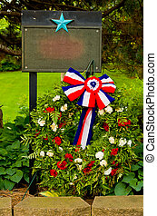 American Memorial with A Red, White and Blue Bowed Flag with...