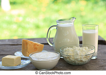 Dairy products on wooden table, selective focus, shallow...