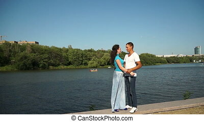 Couple in love near the pond - Couple in love outdoors