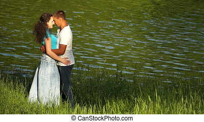 Loving couple near the water