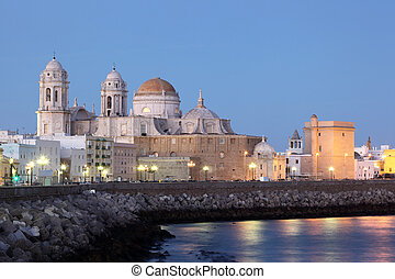 Cathedral in Cadiz illuminated at dusk, Andalusia Spain