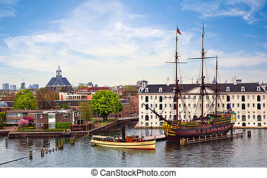 Panorama of Amsterdam with VOC Ship - View on Amsterdam and...