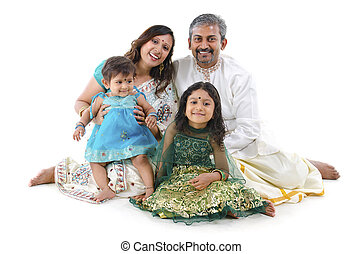 Indian family - Happy Indian family sitting on white...