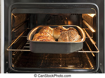 Bread in oven - Bread on the metal cookie sheet in the oven