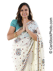 Indian woman greeting - Mid Adult Indian woman in a greeting...