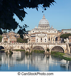 River Tiber, Ponte Sant Angelo and St Peters Basilica in the...