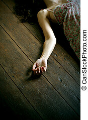 dead woman lying on the floor, focus on the hand