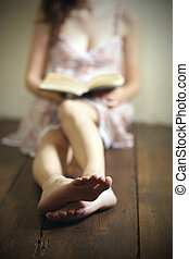 reading a book - young woman reading a book on the old...