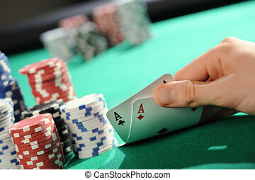 Poker texas holdem: Two Aces - Player looking down at a...